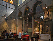 The Patriarchal Cathedral Basilica of Saint Mark is the cathedral church of the Roman Catholic Archdiocese of Venice, northern Italy. It is the most famous of the city's churches and one of the best known examples of Italo-Byzantine architecture.
