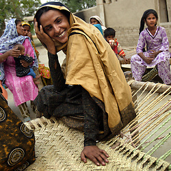 Mukhtar Mai, 33, is seen with relatives during a visit her to aunts house, whom she hadn't seen in four years in Meerwala, Pakistan, April 28, 2005. Mai, went against the Pakistani tradition of committing suicide when she brought charges against the men who gang raped her nearly three years ago.