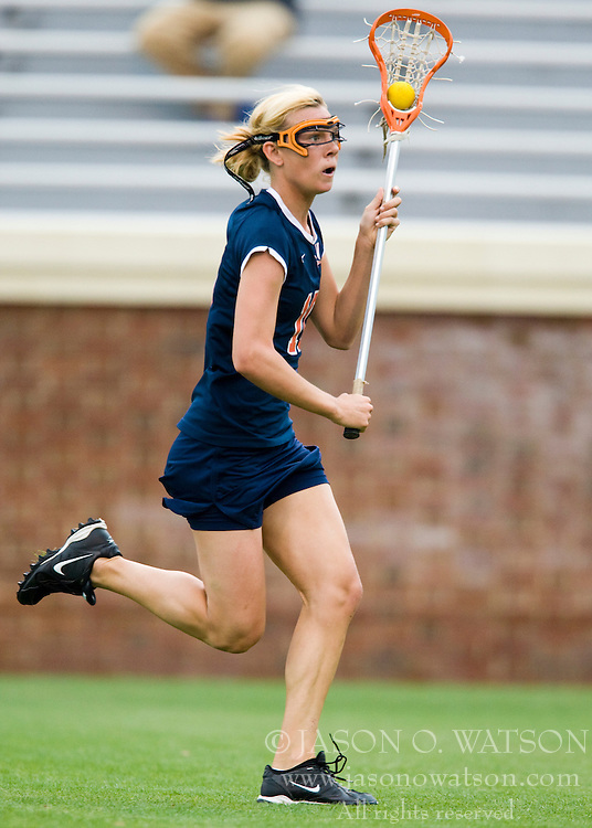 Virginia Cavaliers M Kaitlin Duff (10) in action against Maryland.  The #3 ranked Virginia Cavaliers defeated the #2 ranked Maryland Terrapins 10-9 in overtime in the finals of the Women's 2008 Atlantic Coast Conference Lacrosse tournament at the University of Virginia's Scott Stadium in Charlottesville, VA on April 27, 2008.