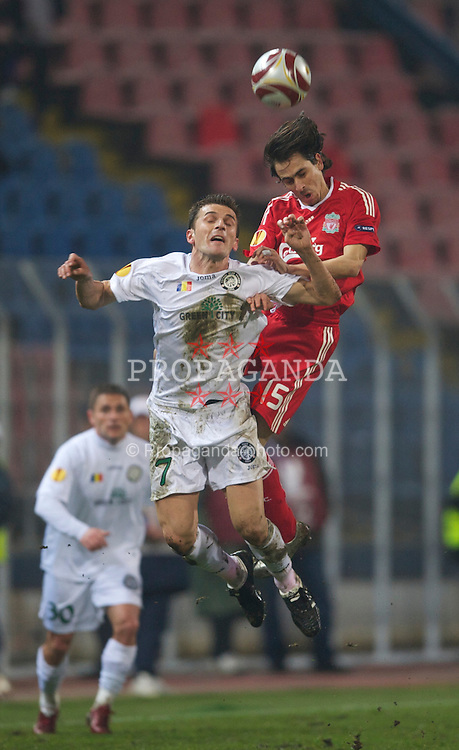 BUCHAREST, ROMANIA - Thursday, February 25, 2010: Liverpool's Yossi Benayoun and FC Unirea Urziceni's Marius Ioan Bilasco during the UEFA Europa League Round of 32 2nd Leg match at the Steaua Stadium. (Photo by David Rawcliffe/Propaganda)