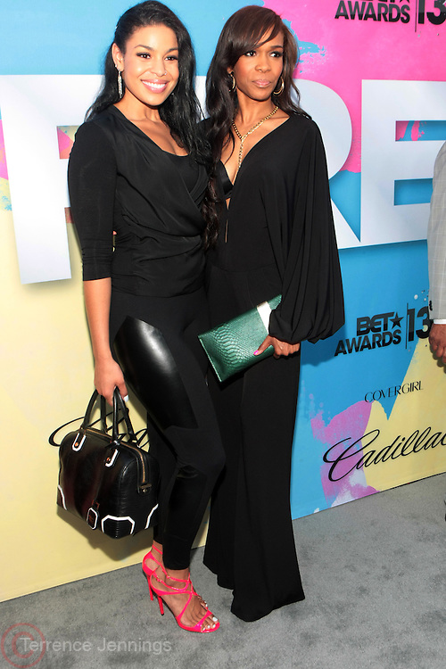 """Los Angeles, CA-June 29:  (L-R) Recording Artists Jordin Sparks and  Michelle Williams attend the Seventh Annual """" Pre """" Dinner celebrating BET Awards hosted by BET Network/CEO Debra L. Lee held at Miulk Studios on June 29, 2013 in Los Angeles, CA. © Terrence Jennings"""