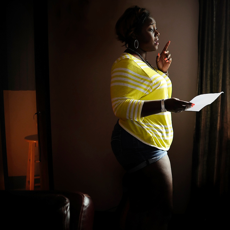 Nekita Waller goes over her lyrics before heading in to the recording booth.
