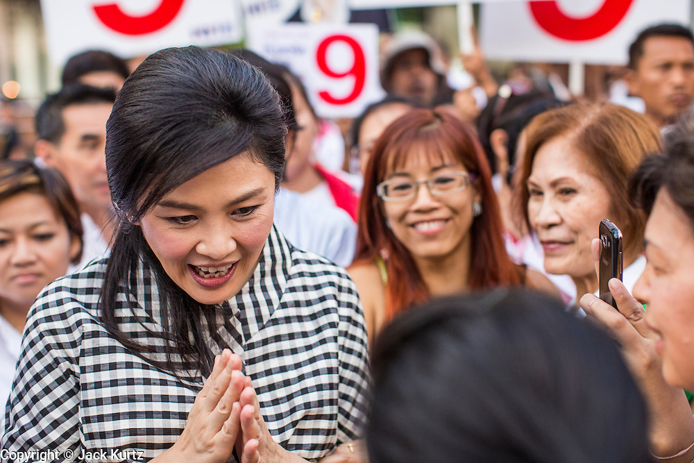 27 FEBRUARY 2013 - BANGKOK, THAILAND:  YINGLUCK SHINAWATRA, Prime Minister of Thailand, campaigns on behalf of Pongsapat Pongchareon in Bangkok. Police General Pongsapat Pongcharoen (retired), a former deputy national police chief who also served as secretary-general of the Narcotics Control Board is the Pheu Thai Party candidate in the upcoming Bangkok governor's election. (He resigned from the police force to run for Governor.) Former Prime Minister Thaksin Shinawatra reportedly personally recruited Pongsapat. Most of Thailand's reputable polls have reported that Pongsapat is leading in the race and likely to defeat Sukhumbhand Paribatra, the Thai Democrats' candidate and incumbent. The loss of Bangkok would be a serious blow to the Democrats, whose base is the Bangkok area.    PHOTO BY JACK KURTZ