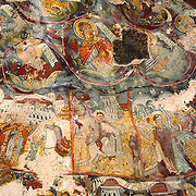"""This colorful old Greek Orthodox Christian fresco ceiling is at Sumela Monastery, under restoration in this 1999 image. The 1000-year-old Monastery of the Virgin Mary at Sumela is among the most impressive sights of Turkey's Black Sea coast. The monastery, founded in AD 386, clings to a cliff above a cool evergreen forest in Altindere National Park, in the Maçka district of Trabzon Province in the modern Republic of Turkey. The Sumela Monastery (Greek: Μονή Παναγίας Σουμελά, Moní Panagías Soumelá; Turkish: Sümela Manastırı) is a Greek Orthodox monastery dedicated to the Virgin Mary (Panagia, meaning """"All Holy"""" in Greek) at Melá Mountain (Turkish: Karadağ, which is a direct translation of the Greek name Ssou Melá, """"Black Mountain"""") within the Pontic Mountains (Turkish: Kuzey Anadolu Dağları) range."""