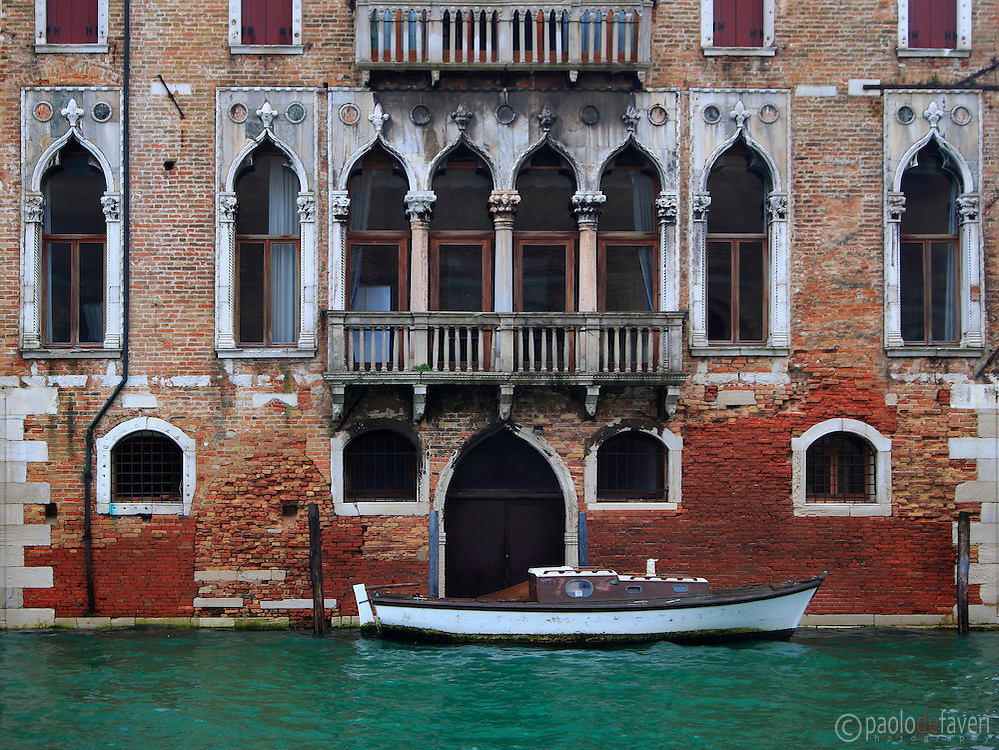 The facade on the Rio della Misericordia of Ca' Pesaro Papafava, a XIV century palace in the Sestiere of Cannaregio in Venice, Italy
