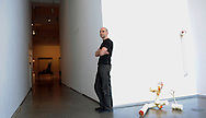 David Opdyke is an artist,  whose conceptional sculptures tend to draw from his background as a model maker, who has been living and working in Brooklyn, New York, since 1995. He recently found a new gallery to represent him and, as a result, was asked to put together work for a solo show.  Here, Opdyke waits for guests to arrive to the opening of the show at the Bryce Wolkowitz Gallery in New York, New York, USA, 19 April 2012. The show, titled, 'Accumulated Afterthoughts', runs until 25 May 2012.