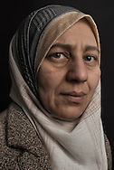 "Lebanon, Jbeil region.Hassiba Abdel Hassib 45, was forced to flee Homs almost four years ago. Their family house was destroyed in late 2011. Since then, she lives as officially registered refugee with her husband, Jassin Abdul Jalil (48) their three children Nidal (15), Yasmina (11) and Mohammed Taha (5), in Lebanon around the city of Jbeil/Byblos, about 35 km north of Beirut. Some relatives are still in Syria, but they can not be in touch with them anymore. ""The night when the bombs centered our house, I ran to enter my youngest child bedroom, I was afraid Mohammed was still asleep. I took him with me, I took our family book and we start to ran, as the bombing was going on. I arrived at the Lebanese border just with the clothes I was wearing that day. That's why the objects I care the most is our family documents. Within the pages is written our family memory. Ourselves"". Alessio Romenzi"
