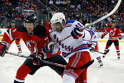 March 19, 2008; Newark, NJ, USA;  New Jersey Devils defenseman Paul Martin (7) and New York Rangers left wing Nigel Dawes (10) race to the puck during the first period at the Prudential Center in Newark, NJ.