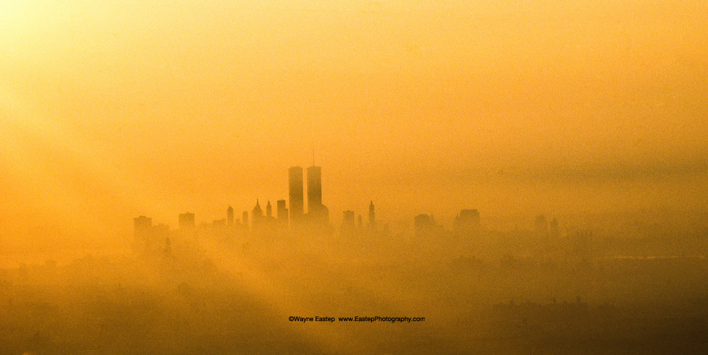 View from airplane at sunrise of World Trade Center, NY, NY