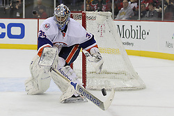 Apr 3; Newark, NJ, USA; New York Islanders goalie Al Montoya (35) plays the puck during the second period of their game against the New Jersey Devils at the Prudential Center.