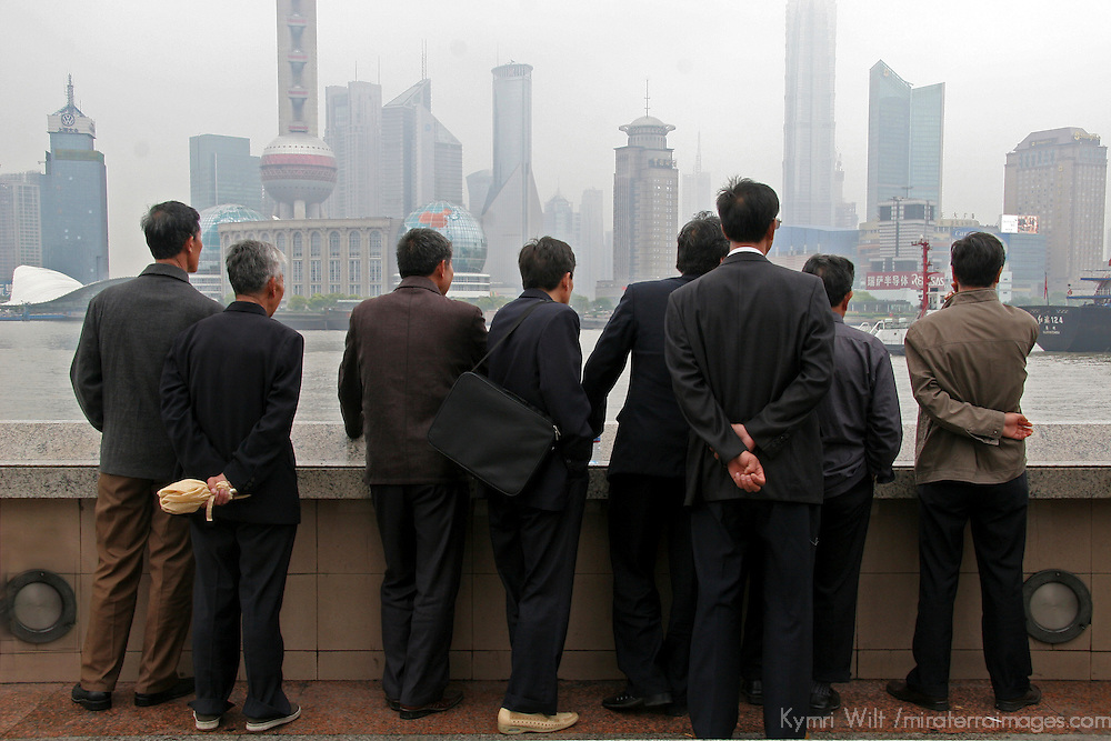 Asia, China, Shanghai. Businessmen on the Bund.