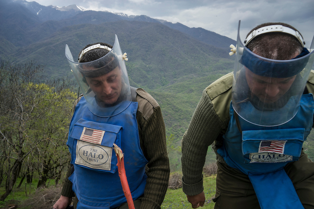 HAGOB KAMARI, NAGORNO-KARABAKH - APRIL 20: Samvel Karapetyan (L), a sapper with the charity HALO Trust, and Rudik Sargsyan, commander of mine clearance team six, work to clear a minefield on April 20, 2015 in Hagob Kamari, Nagorno-Karabakh. Since signing a ceasefire in a war with Azerbaijan in 1994, Nagorno-Karabakh, officially part of Azerbaijan, has functioned as a self-declared independent republic and de facto part of Armenia, with hostilities along the line of contact between Nagorno-Karabakh and Azerbaijan occasionally flaring up and causing casualties. (Photo by Brendan Hoffman/Getty Images) *** Local Caption *** Samvel Karapetyan; Rudik Sargsyan