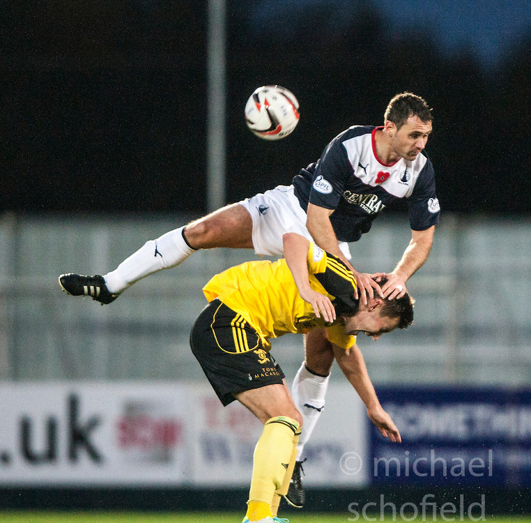 Falkirk's David McCracken over  Livingston Andy Barrowman.<br />