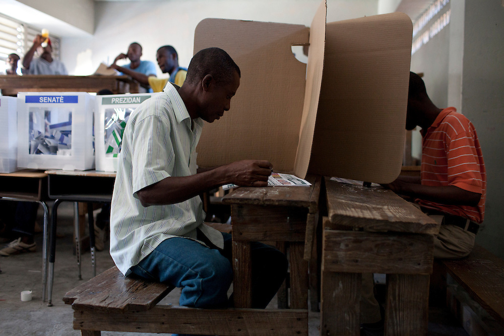 Voters cast their ballots during presidential and legislative elections at a polling station in Port-au-Prince, Haiti.