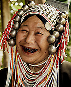 An Akha hill tribe woman's teeth are stained deep red from chewing betel nut, a sign of beauty in Thailand.