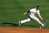 Mar 21, 2013; Lake Buena Vista, FL, USA; Atlanta Braves shortstop Andrelton Simmons (19) lunges for a ground ball during the second inning against the Washington Nationals at Champion Stadium.