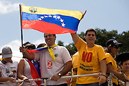 Venezuelan opposition's lider, Yon Goicochea (c) takes part in a campaign rally against Venezuelan President Hugo Chavez's proposal of constitutional changes in Caracas, February 7, 2009. Venezuelans will vote on February 15 on proposed changes to the constitution allowing Chavez and other politicians to stay in office as long as they keep winning elections. (Photo/Ivan Gonzalez)