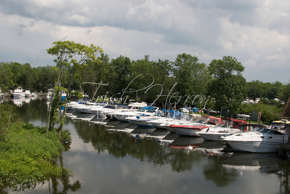 Recreational boats are docked in a quiet inlet off the Connecticut River near Essex, Connecticut.
