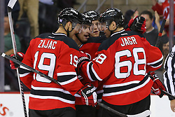 Oct 21, 2014; Newark, NJ, USA; The New Jersey Devils celebrate a goal by New Jersey Devils center Adam Henrique (14) during the second period at Prudential Center.