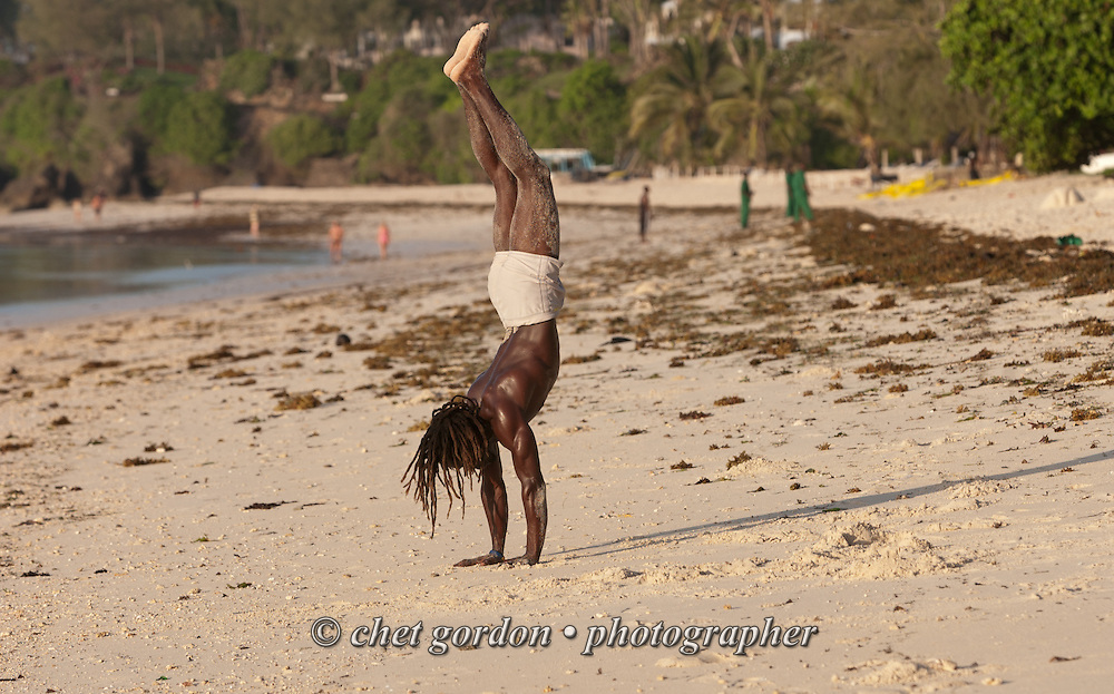 A man exercises on the beach at the Serena Beach Hotel in Mombasa, Kenya on Wednesday, April 12, 2006.