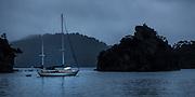 Yacht Ichiban at anchor in Kiwiriki Bay, Port Fitzroy, Great Barrier Island.