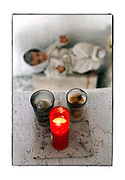 SHOT 12/6/10 2:45:36 PM - Candles burn beside a baby Jesus doll in a small roadside capilla near Santa Cruz, Mexico. Roadside capillas, or tiny chapels, in the Mexican state of Quintana Roo. The capillas are common along the roads and highways of Mexico which is heavily Catholic and are often dedicated to certain patron saints or to the memory of a loved one that has passed away. Often times they contain prayer candles, pictures, personal artifacts or notes. (Photo by Marc Piscotty / © 2010)