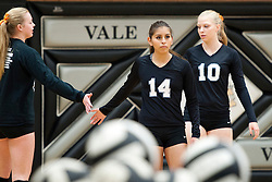 Vale (L to R: Abby Hamilton, AdriAna Medina, Tessa McFetridge) warms up before the start of the 2015 OSAA 3A Volleyball State Championship, Round 1, Vale - St. Mary's at  Vale High School, Vale, Oregon. October 31, 2015.<br /> <br /> Vale defeated St. Mary's of Medford in three games 25-10,  25-8, 25-13, improving their season record to 24-2.