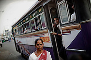 A Tamil woman exits a bus in Colombo, Sri Lanka, July 2, 2009. With the end of the 26 war between the Sri Lankan government and the LTTE, security in the capital city remains on high alert.