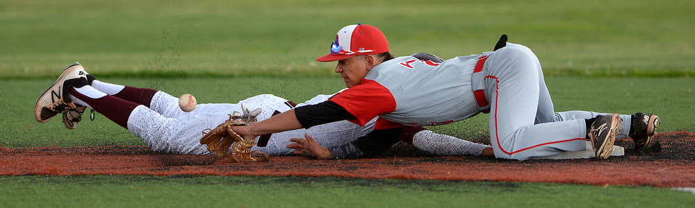 gbs042517m/SPORTS -- The ball bounces away from the glove of West Mesa second baseman Oscar Medrano as Valley's Isaiah Chavez dives back to secong base in the 3rd inning of the game at Valley on Tuesday, April 25, 2017.  (Greg Sorber/Albuquerque Journal)