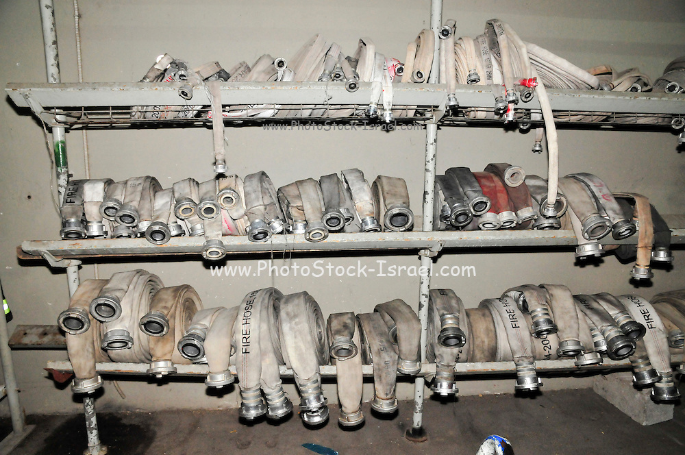 Fire fighters equipment hoses on a rack