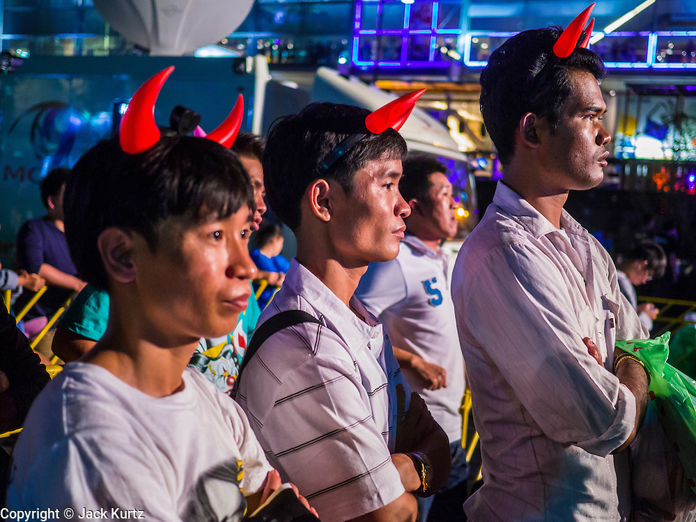 31 DECEMBER 2012 - BANGKOK, THAILAND:  Thai men wearing devil's horns at the New Year's Eve party and countdown in the Ratchaprasong intersection in Bangkok. The traditional Thai New Year is based on the lunar calender and is celebrated in April, but the Gregorian New Year is celebrated throughout the Kingdom, especially in larger cities and tourist centers, like Bangkok, Chiang Mai and Phuket. The Bangkok Countdown 2013 event was called ?Happiness is all Around @ Ratchaprasong.? All of the streets leading to Ratchaprasong Intersection were closed and the malls in the area stayed open throughout the evening.   PHOTO BY JACK KURTZ