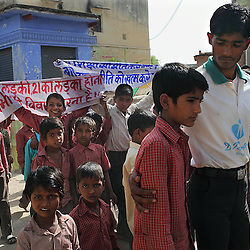 School children participate in an anti-child marriage demonstration in Rajasthan, India on April 25, 2009. The demonstration is held around  the Hindu holy day of Akshaya Tritiya, or Akha Teej, a day when child marriage commonly takes place. The protests, which occurred through several villages, were organized by the Shive Health Organization.