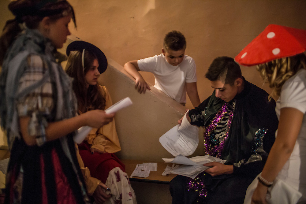 MARIUPOL, UKRAINE - SEPTEMBER 1, 2015: Students at School 68 review lines for a skit they will perform for first-year students on the first day of the new school year in Mariupol, Ukraine. On January 24 of this year, shelling in the same neighborhood killed 31 people, all civilians, and while much recent fighting has been concentrated near Mariupol, a drop in ceasefire violations in the past few days has been credited to a desire to not interfere with the start of the new school year. CREDIT: Brendan Hoffman for The New York Times
