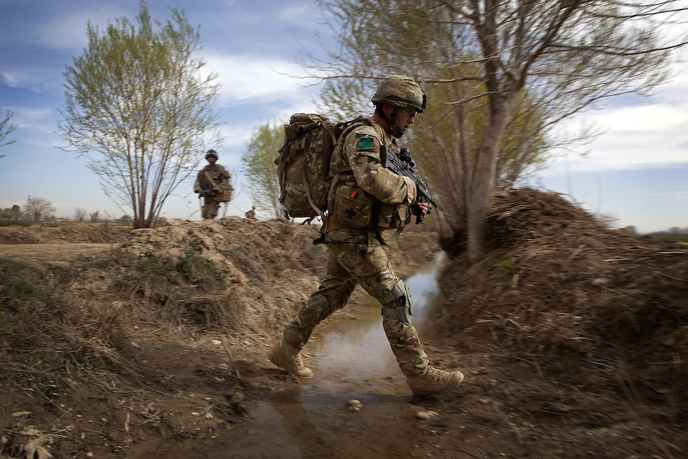 British soldiers from 3PARA patrol towards a counter IED shura in Nad Ali, Hemand Province, Afghanistan on the 10th of March 2011.