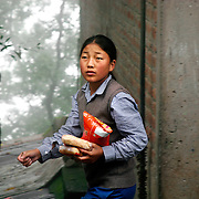A Tibetan student buys snacks during a break from class at TCV, the Tibetan Children's Village in Dharamsala, India. This is a school for Tibetan exile children run by the Tibetan government-in-exile.