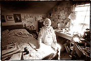 Elderly woman living by herself, and with her family