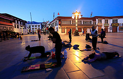 A picture made available on 19 September 2016 of Tibetan pilgrims praying and prostrating outside the Jokhang Temple in the early morning in Lhasa, Tibet Autonomous Region, China, 09 September 2016. Jokhang Temple is considered one of the most sacred site for Tibetan buddhists built during the rule of King Songtsen Gampo in the 7th century.