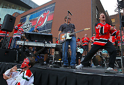 May 30; Newark, NJ, USA; A New Jersey Devils fan leads a cheer before the 2012 Stanley Cup Finals Game 1 at the Prudential Center.  The Kings defeated the Devils 2-1.