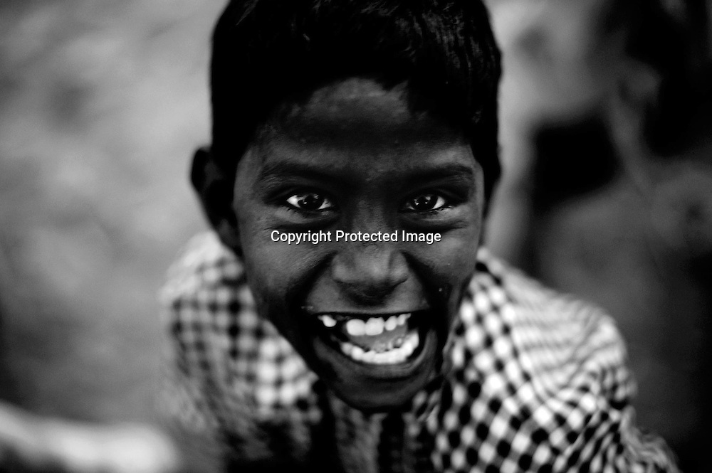 Shyam Babu, 8,  who suffers cerebral palsy plays near the site of the deserted Union Carbide factory on November 27, 2009 in Bhopal, India. A quarter century later, many of those who were exposed to the gas have given birth to physically and mentally disabled children...Twenty-five years after an explosion causing a mass gas leak, in the Union Carbide factory in Bhopal, killed at least eight thousand people, toxic material from the 'biggest industrial disaster in history' continues to affect Bhopalis. A new generation is growing up sick, disabled and struggling for justice.