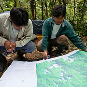 Walter Quertehuari, head of the Haramba Queros Wachiperi Ecological Reserve, reviews a map of the concession with another park guard. The conservation concession of the Communidad Nativa de Queros-Wachiperi near Pilcopata. The Queros Community has a community cultural tourism project and holds the title to a conservation concession of almost 7000 hectares near their community. They are the first idigenous group to be granted management of a conservation concession in Peru. The concession is pre-montane rainforest and they hold the title for 40 years with hopes of renewal.