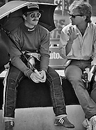 Journalist  and good friend Peter Windsor poses a question to Lotus F1 driver Nigel Mansell before the start of the 1984 Detroit Grand Prix. <br />