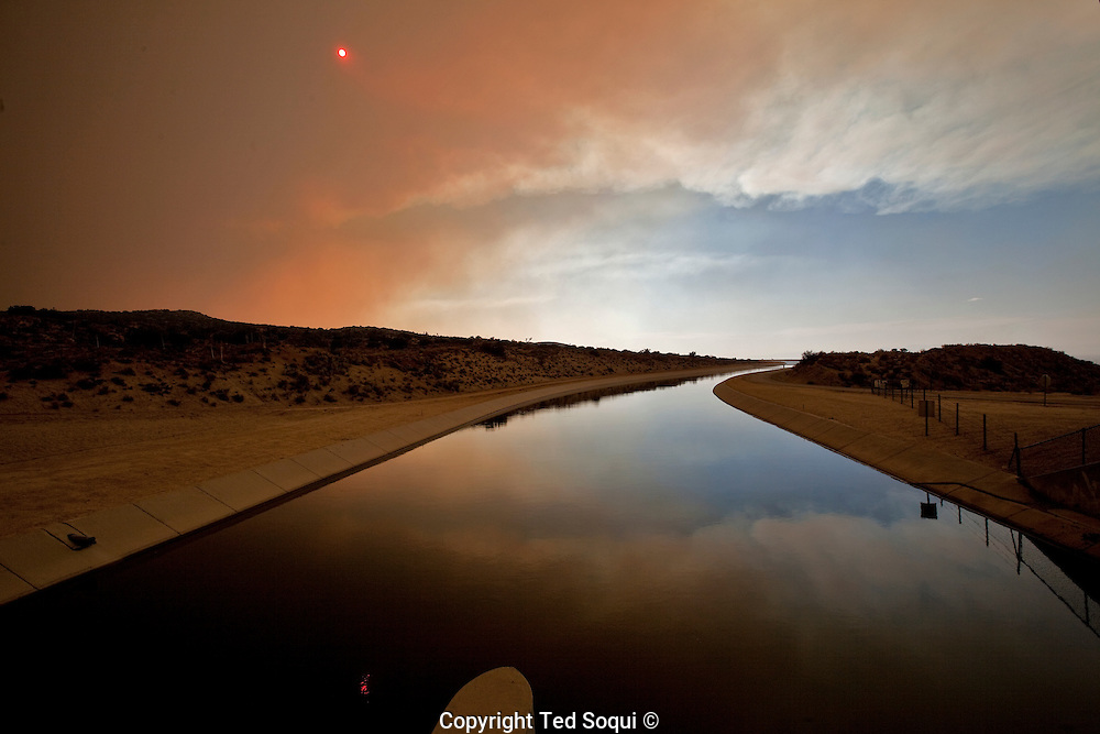 View of the smoke from the Station fire at the California aqueduct near Palmdale, CA..Station fire near Acton, CA. .