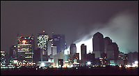 September 13, 2001: The Travelers Building at 388 Greenwich Street shows signs of rain<br /> falling on a smoldering ground zero after terrorists flew two hijacked airplanes into two<br /> World Trade Centers in lower Manhattan in New York City tuesday morning. 2,713 people<br /> were killed by Islamic terrorist Osama bin Laden as he declares The Jihad (Holy War)<br /> against The United States of America. View from Hoboken, NJ. &copy;2001ShellyCastellano.com<br /> <br /> ________________________________<br /> 13 September 2001: View of smoke smoldering ashes burning in the rain only two days after the Terrorist attack on the America's. View of  Lower Manhattan, NY from Hoboken NJ. Area surrounding ground zero where the World Trade Centers WTC once stood only hours after they fell to the ground in New York.  Islamic terrorist Osama bin Laden declares The Jihad or Holy War against The United States of America on September 11, 2001. Headline news photos available for editorial use.