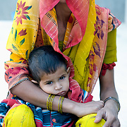 Veiled mother from Rajasthan (India) with her son.