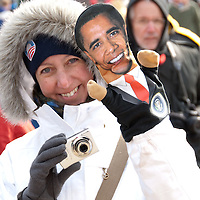 A woman has a Barack Obama puppet on her left hand during the 2009 Inauguration in Washington, DC.