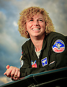 Jill has been a aerial refuling tanker pilot, flown an A-10 Warthog on over 50 combat missions in Afghanistan, and has been a squadron commander in Germany.  In her spare tiime, she flies a Pitts S2B doing aerobatic routines at airshows across the country.  Photographed for Women In Aviation during Airventure 2009, in Oshkosh, Wisconsin.