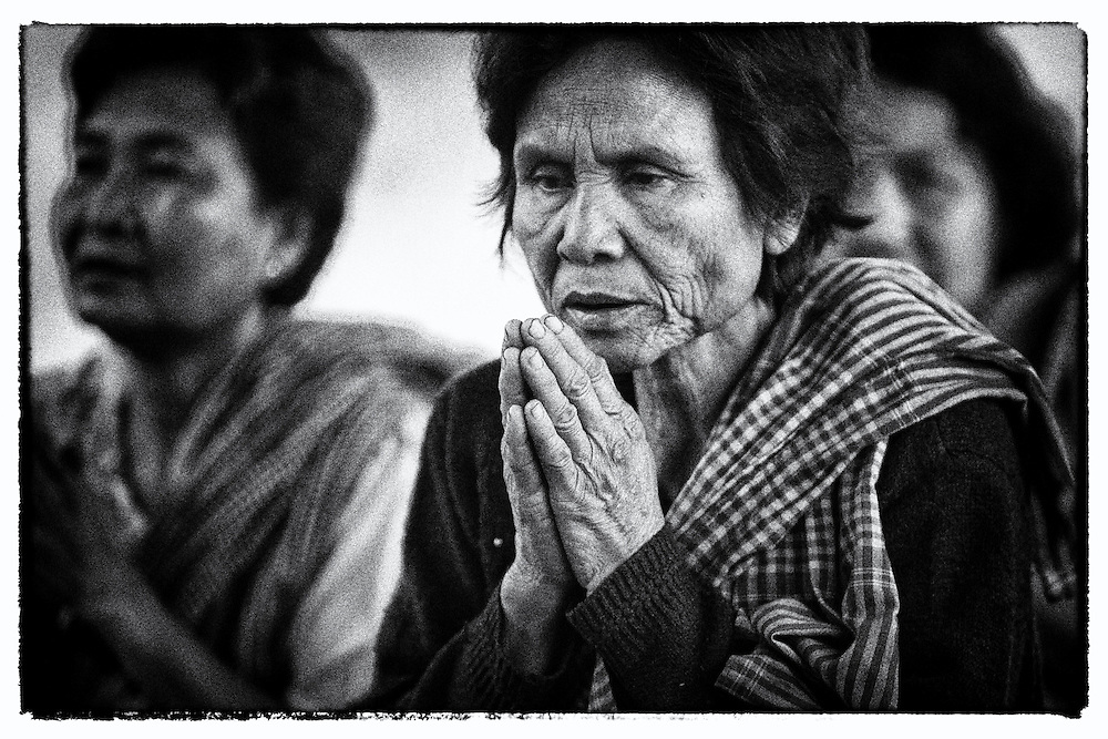Former Khmer Rouge Soldiers and others gather to offer Buddhist prayers at a new settlement near Pailin, Cambodia on the Thailand border.  Under the Khmer Rouge religion was outlawed.