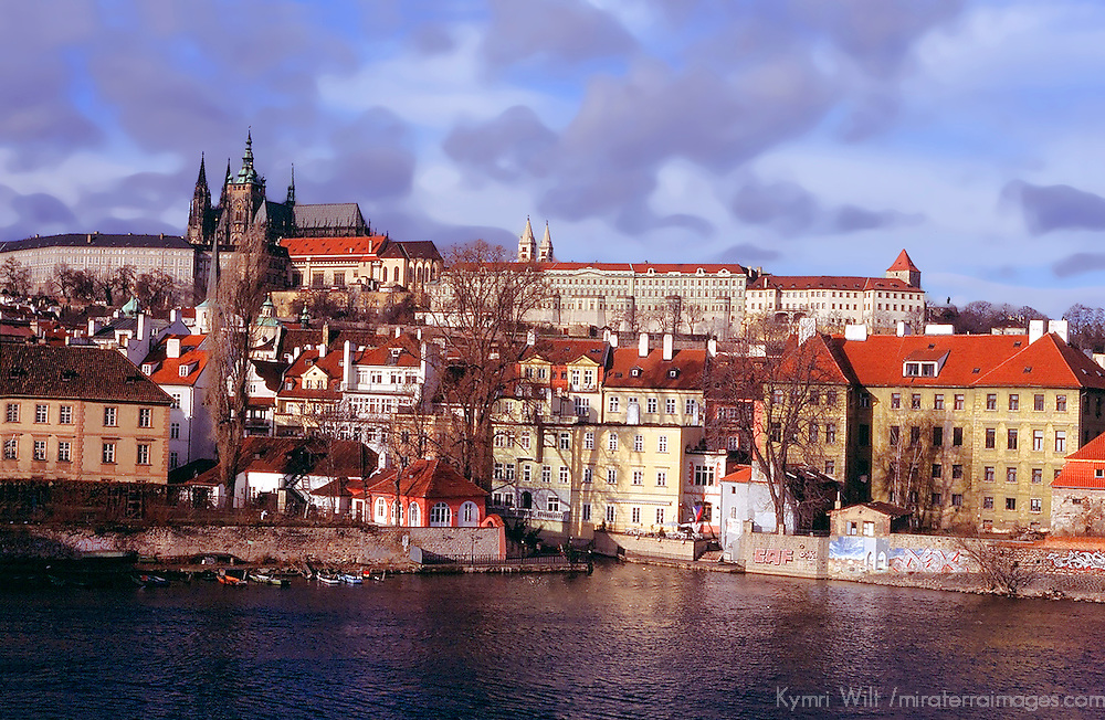 Europe, Czech Republic, Prague. Dramatic view over the river towards the Castle in Prague.
