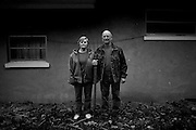Dave Bircher, 71, poses for a portrait with his wife, Nancy. Bircher has farmed the rolling hills of Southeast Ohio for more than thirty years. 'Honestly, we're farming because we love to farm. We're not farming because we're making any money,' says Bircher.