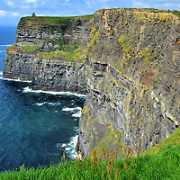 Stone Amphitheater at Cliffs of Moher near Liscannor, Ireland<br /> You are immediately impressed at your first glimpse of the Cliffs of Moher. As you walk south along the edge, the views get more incredible.  Nature spent 300 million years dating back to the Carboniferous Period carving this amphitheater of Namurian shale and sandstone. At the base is a network of water caves.  No wonder this has been the location of numerous movies such as &ldquo;Harry Potter and the Half-Blood Prince&rdquo; and &ldquo;The Princess Bride.&rdquo;
